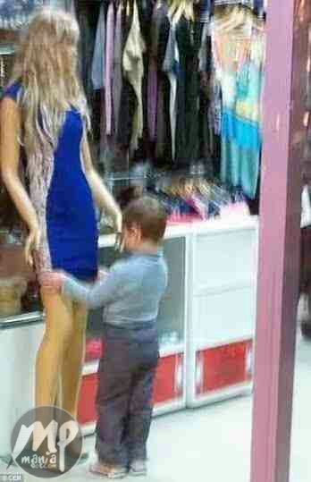 Small Boy Caught Looking Under a mannequin's private part (Photos)